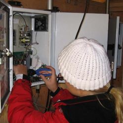 Image: a UCD staff member works on an open module at a sampler site visit.