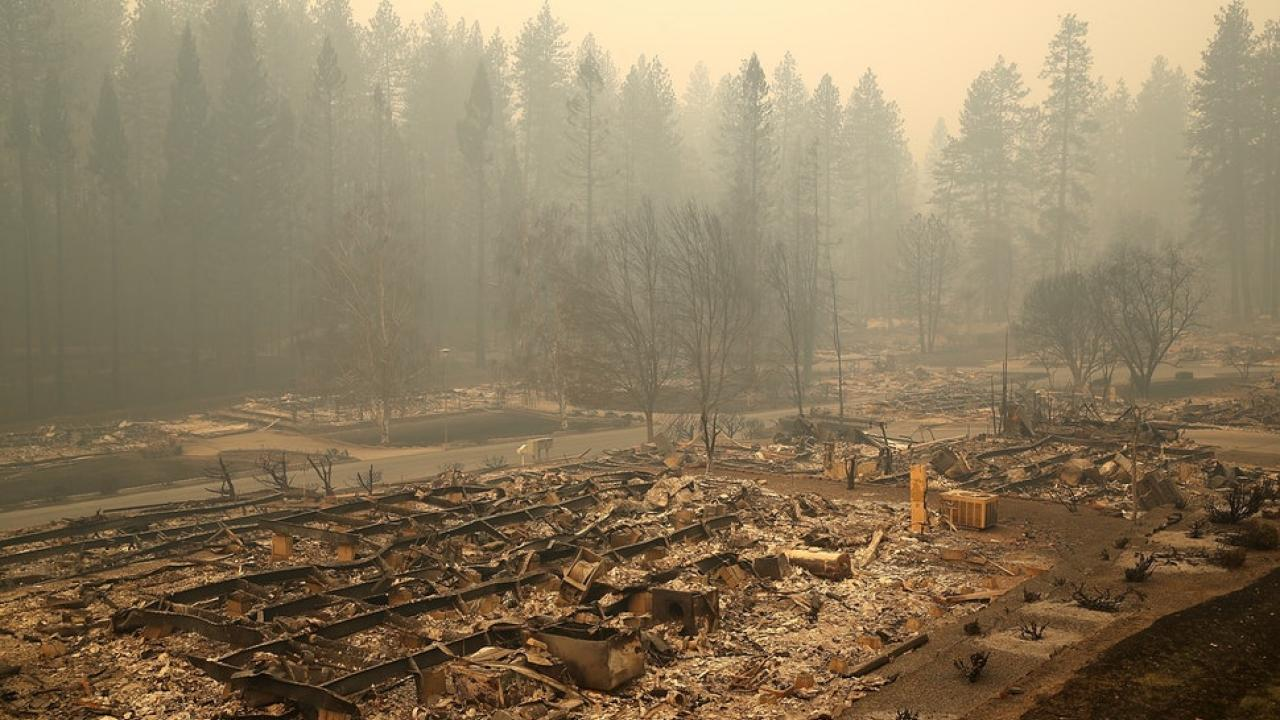 Image: after-effects of the air quality from California's Camp fire depicting lingering smoke and charred ground.